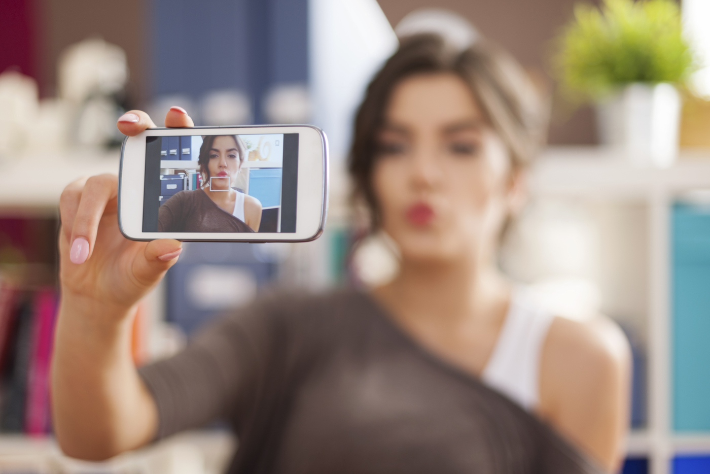 Beautiful woman taking selfie photo with blowing a kisses